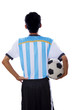Soccer player holding a soccer ball isolated