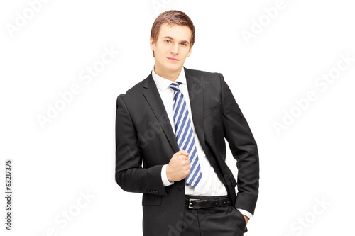 Businessman in formalwear leaning against wall