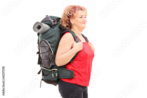 Mature woman, walking with backpack