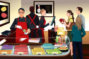 Customers buying macaroons