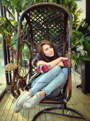 girl sitting on the balcony
