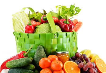 Green shopping bag with groceries isolated on white