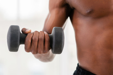 Man training with dumbbells.