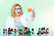 chemist woman with chemical glassware flask