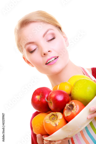 Housewife or chef in kitchen apron offering fruits isolated