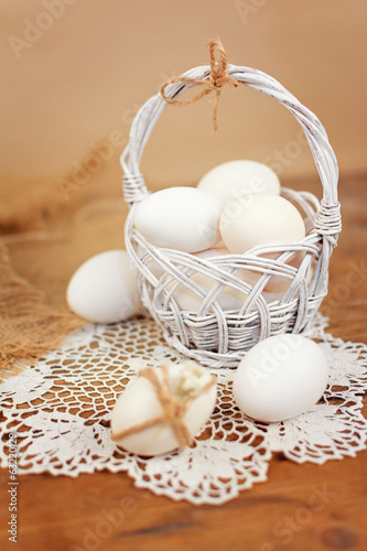 Retro white basket with Easter eggs