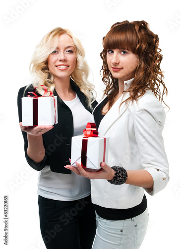 two girls give gifts