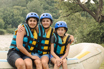 Two women and a child going rafting