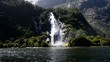 Spectacular waterfall in Milford Sound fiord, New Zealand.
