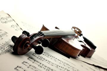 Violin on sheet music. Vintage style.