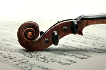Peg box and scroll of violin. Close up. Vintage Style.