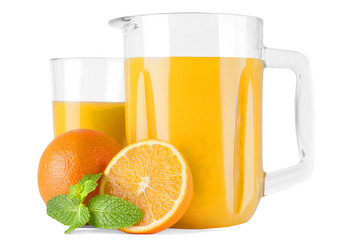 Glass pitcher with orange juice and oranges
