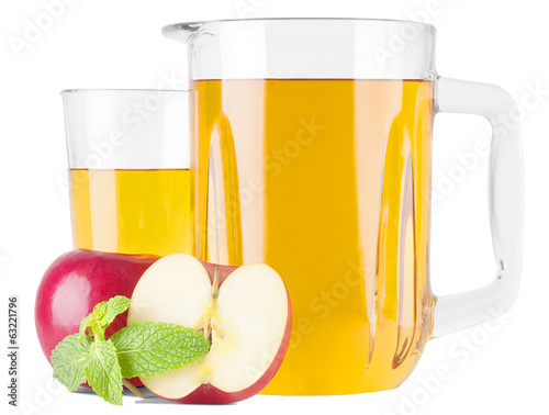 Glass pitcher with apple juice and apple