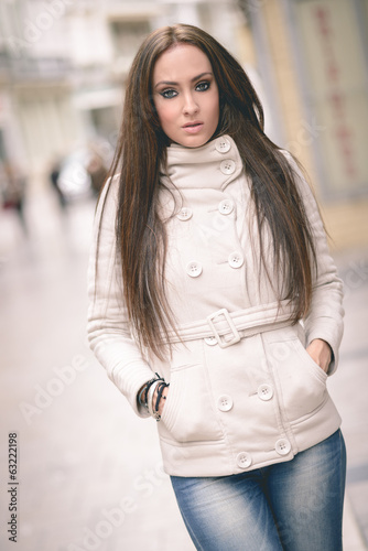 Young woman, wearing casual clothes, with long hair