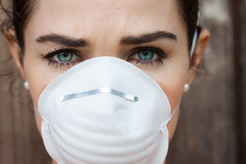 Close-up woman wearing a face mask