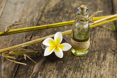 frangipani ,salt in bowl and bamboo grove on old wood