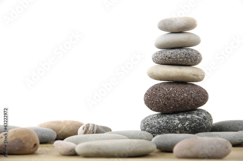 stacked stones on a wood board