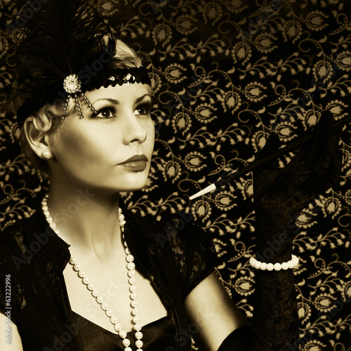 Retro Woman with Cigar. Portrait of Fashion Beautiful Blonde