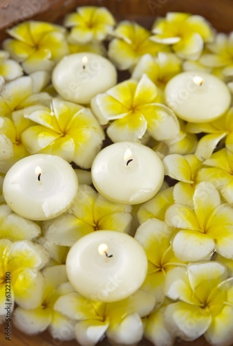 wooden bowl in many white and yellow frangipani