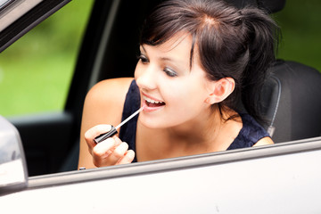 beautiful young woman in the car,