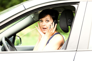 calling young woman in the car