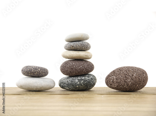Three stacked stones on a wood board