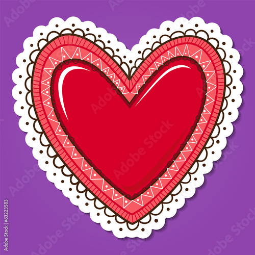 Glossy heart with lace edging.