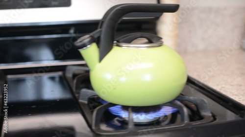 Dolly move on tea kettle on gas stove