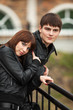 Happy young couple in leather jackets outdoor
