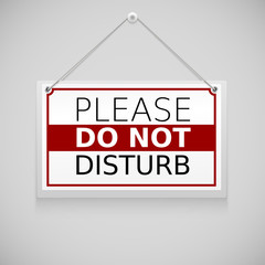 Please do not disturb, sign hanging on the wall