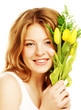 young smiling woman with yellow tulips