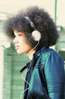 Young, modern woman with headphones,