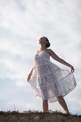 Girl in white on background of sky