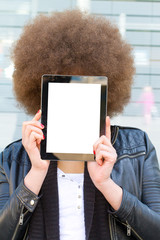 Young woman with afro hair cut and empty tablet
