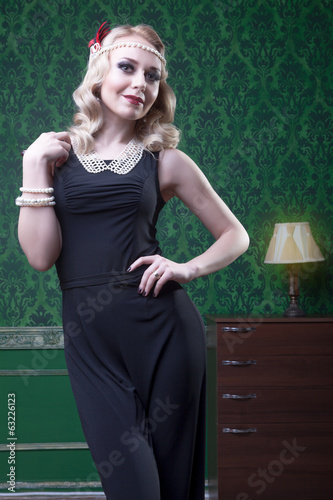 Sensual blonde in green vintage room