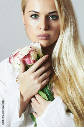 beautiful blond woman with flowers.girl and roses.white flower