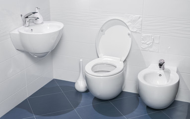detail of a luxurious bathroom with sink, toilet and bidet