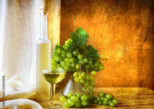 Still life fruit bottlle wine grapes