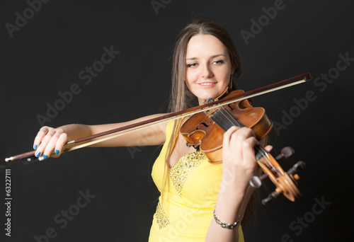 violinist in yellow dress