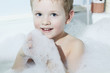 Smiling Little Boy in the Bath.Funny Child in Foam. Blue Eyes