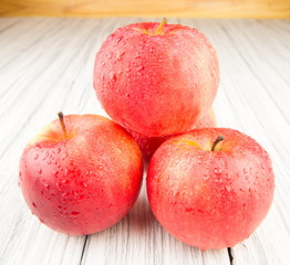 Red apple on old wood background