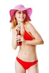 Woman in beachwear enjoys a drink