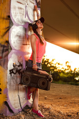 Young woman with a tape recorder and headphones