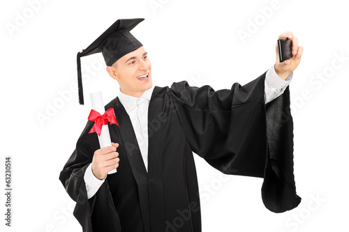 College graduate taking a selfie with phone