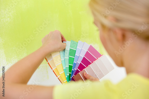 Woman choosing color for wall