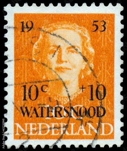 Stamp printed in Netherlands, shows portrait of Queen Juliana
