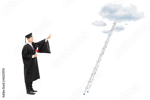Male graduate student pointing towards the clouds