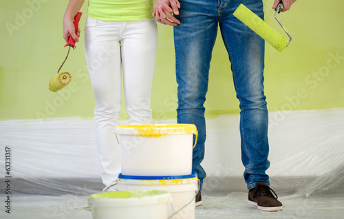 Couple with equipment for painting