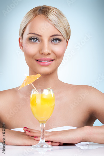 young beautiful blonde woman drinking cocktail