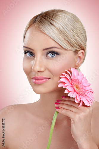 Tender woman with pink flower